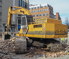 Building Demolition Contractors demolish church in UpTown Charlotte with Excavator. Image by W.C. Black and Sons, Inc.