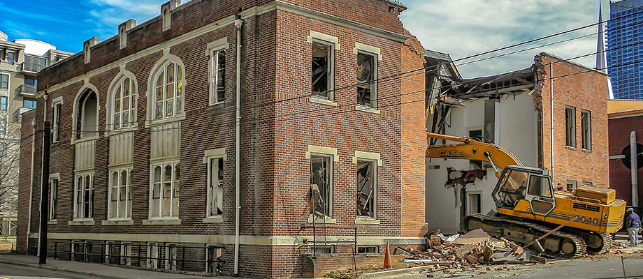 CASE Excavator demolishing old church sanctuary building in Uptown Charlotte. Photo by W.C. Black and Sons, Inc.
