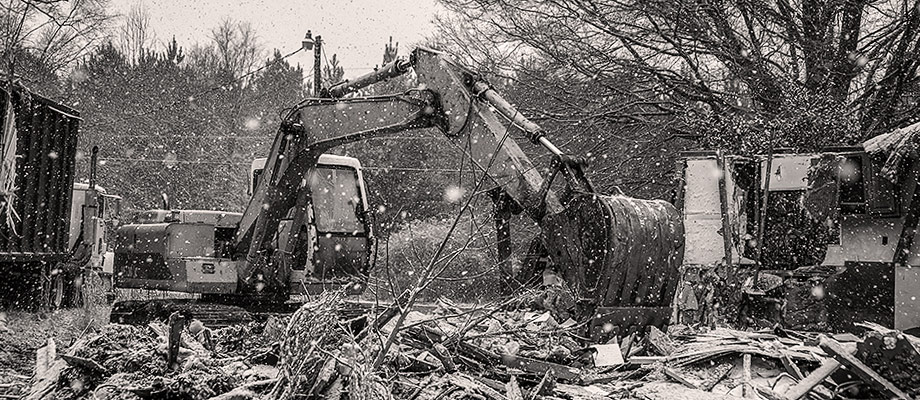 House Demolition during snow storm in 2014. Image by W.C. Black and Sons, Inc.
