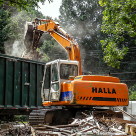 HALLA HE130-LCE Excavator loads demolition debris onsite of a demolition project in Charlotte, NC. Image by W.C. Black and Sons, Inc.